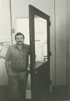 Nunez standing in a doorway