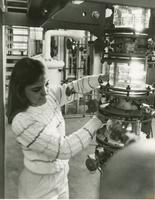 Woman workingin with machinery