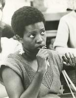 Woman chewing on a pen