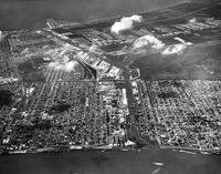 Aerial view of Eighth and Ninth Wards from the Mississippi River to Lake Pontchartrain, centered at Industrial Canal
