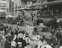 Elks Krewe of Orleanians Parade Float [cave men] on Canal Street