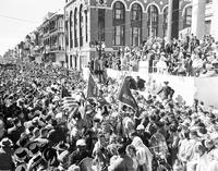Crowd in front of Gallier Hall Grandstand with view up St. Charles Avenue toward Lee Circle