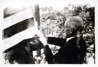 Rev. D.B. Spencer raising flag