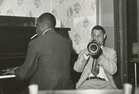 Alton Purnell and Ernie Cagnolatti playing the piano and trumpet