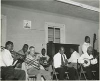 Many members of the Lawrence Marrero Polo Barnes New Orleans Jazz Band rehearsing at the Autocrat Club